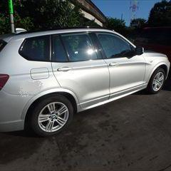 BMWのX3(LDA-WY20):右フロントドア修理費用、塗装 作業工賃180,000円/合計金額194,400円(税込)