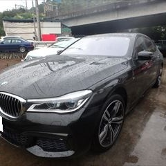BMWの7シリーズ(CBA-7F44):フロントバンパー修理、塗装 作業工賃60,000円/合計金額(税込)64,800円
